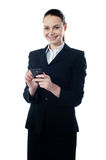 Corporate lady using mobile phone. Sending message Royalty Free Stock Image