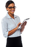 Corporate lady using touch pad device Stock Images