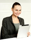 Corporate lady using wireless tablet device Royalty Free Stock Photos