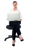 Corporate lady working on her laptop Stock Photos