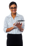 Corporate lady working on tablet device royalty free stock photography