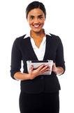 Corporate lady working on tablet device Stock Photography