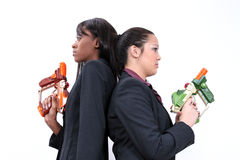 Corporate Laser Tag. Two beatiful business women stand ready to blow away the competition. Look for more in this series. Shot with the Canon 20D stock images