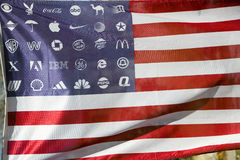 Corporate logos in place of stars on the American. Flag symbolize allegiance to and dominance of Corporate America Stock Images