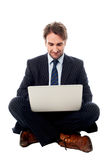Corporate male executive with laptop Royalty Free Stock Image