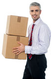 Corporate man with a cardboard box in hand Stock Images