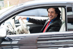 Corporate man driving his car Royalty Free Stock Photography