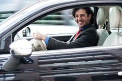 Corporate man driving his car Stock Image