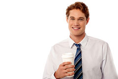 Corporate man holding cold beverage Royalty Free Stock Photos