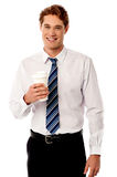 Corporate man holding cold beverage Royalty Free Stock Photo