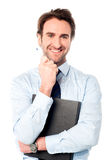 Corporate man holding important file Stock Photos