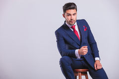 Corporate man leaning on a chair while sitting Royalty Free Stock Photo
