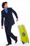 Corporate man looking back with the luggage. In isolated white background Stock Image
