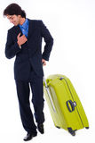 Corporate man looking down with is luggage. On isolated white backround stock image