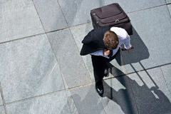Corporate Man With Luggage And Costume Jacket. Upper View Of A Corporate Man With Luggage And Costume Jacket Royalty Free Stock Photos