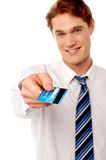 Corporate man offering you credit card Royalty Free Stock Photo