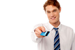 Corporate man offering you credit card Stock Photo