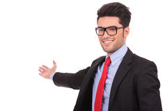 Corporate man presents something in back Royalty Free Stock Image