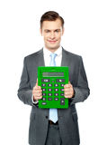 Corporate man showing big calculator Stock Photos