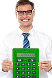 Corporate man showing big green calculator Stock Photo