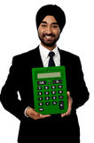 Corporate man showing big green calculator. Smiling indian businessman showing big calculator stock illustration