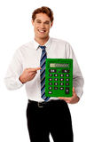 Corporate man showing big green calculator Stock Photos