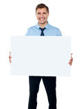 Corporate man showing billboard banner Royalty Free Stock Images