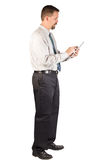 Corporate Man Standing While Using Tablet Stock Photography