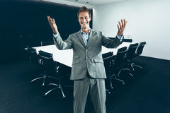 Corporate man in suit in modern Boardroom Royalty Free Stock Photography