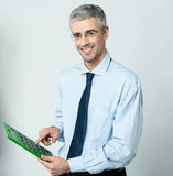 Corporate man using calculator Stock Photo