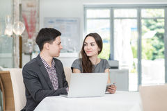 Corporate meeting! Young businesspeople sitting at the table and Royalty Free Stock Photos