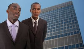Corporate Men. This is an image of two businessmen with a corporate building in the background Stock Image