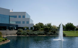 Corporate Office. Large Corporate Building with waterfall pond royalty free stock photos