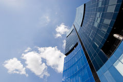 Corporate office building. Modern corporate highrise building reflecting sky with clouds