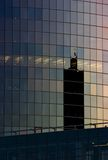 Corporate office building facade. And reflection of other skyscraper in late evening Stock Photography