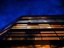 Corporate office building at night stock image