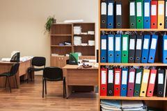 Corporate office room with storage of color folders as archive, nobody Stock Photography