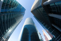 Corporate office skyscrapers perspective. Contemporary urban architecture and business style concept with blue corporate office buildings (skyscrapers) shot by Stock Images