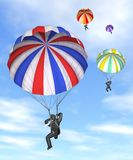 Corporate Parachute. Businessmen descending on their destination in three dimensional render Stock Image