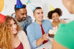 Team greeting colleague at office birthday party Stock Image