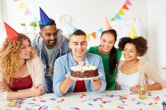 Team greeting colleague at office birthday party Royalty Free Stock Images