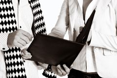 Corporate people 582. Businesswoman and her partner with a black leather folder, soft sepia finish royalty free stock images