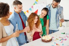 Happy coworkers with cake at office birthday party Royalty Free Stock Images