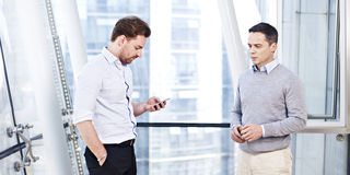 Corporate people handling a situation. Two business executives working together responding to a business situation stock images