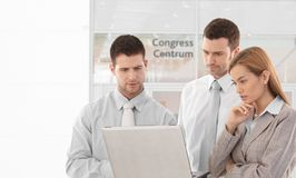Corporate people looking at laptop screen Stock Photography