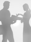 Corporate people looking at a project proposal, silhouette Royalty Free Stock Photos