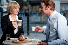 Corporate people toasting coffee at cafe Royalty Free Stock Photography