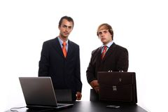 Corporate person using laptop. Two corporate person using laptop Stock Photos