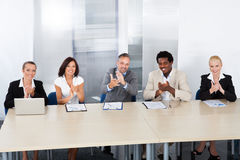 Corporate Personnel Officers Applauding. Group Of Corporate Personnel Officers Applauding In Office royalty free stock photography