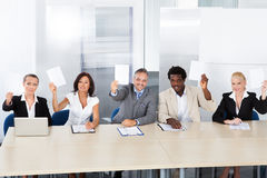 Corporate Personnel Officers Holding Paper Royalty Free Stock Photos
